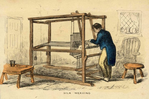 A man in a tailcoat at a silk loom, by a window for light. The loom is taller than he is, and twice as long. It takes up most of the room altogether.