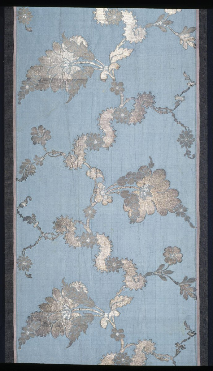 (c)Victoria and Albert Museum, London - This fabric is a brocaded silk and was intended for ladies' gowns. The technique of brocading allowed different colours or types of thread to be introduced into the pattern of a fabric in specific, sometimes very small areas. This was of particular importance in silks woven with metal thread, like this, where the gold or silver was too precious to waste on the back of the fabric where it would not be seen.