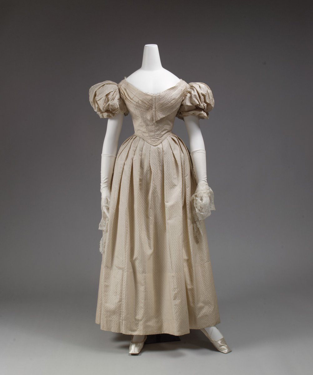 From the Met: Caricaturists of the 1830s focused on the newly fashionable inflated forms that were such a contrast to the body-revealing styles of the previous three decades. The dilation of sleeves and skirts reached such an extreme that women were often satirically depicted as airborne, caught up by gusts of wind trapped under their skirts. In fact, they were weighed down by the sleeve pillows and multiple petticoats required to support their stylish volume.