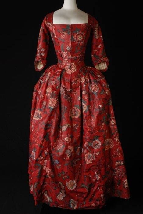 Red background dress with white and green flower pattern. Chintz dress, 1785 - via Pinterest.