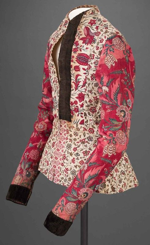 Floral chintz waistcoat with red arms and white base. via Pinterest