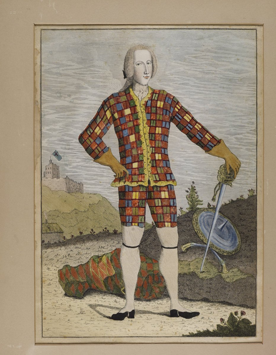 A rather baffling vision of tartan/plaid, and Bonny Prince Charlie. Looks a bit like a circus outfit.