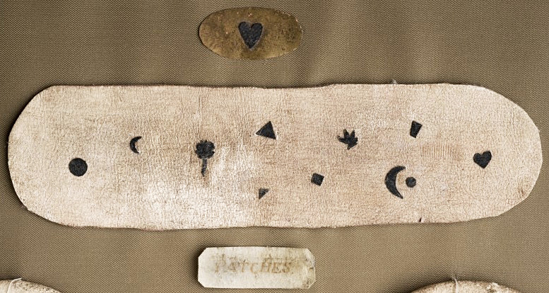 A selection of 18th-century fabric patches. Via the Wellcome Library, London.  Small, different-shaped beauty marks.