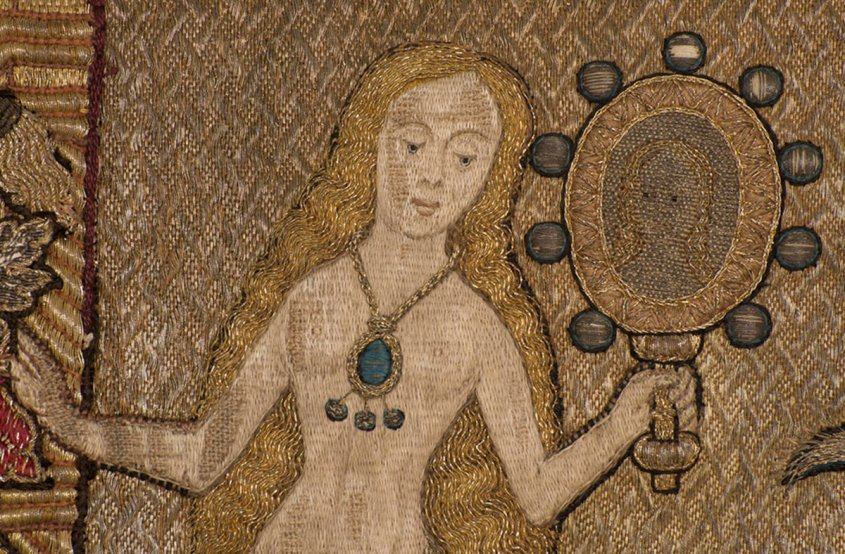 The Fishmongers' Pall (detail showing mermaid), 1512 – about 1538, England. © The Worshipful Company of Fishmongers, London - an intricately detailed embroidery of a mermaid, looking into a mirror.