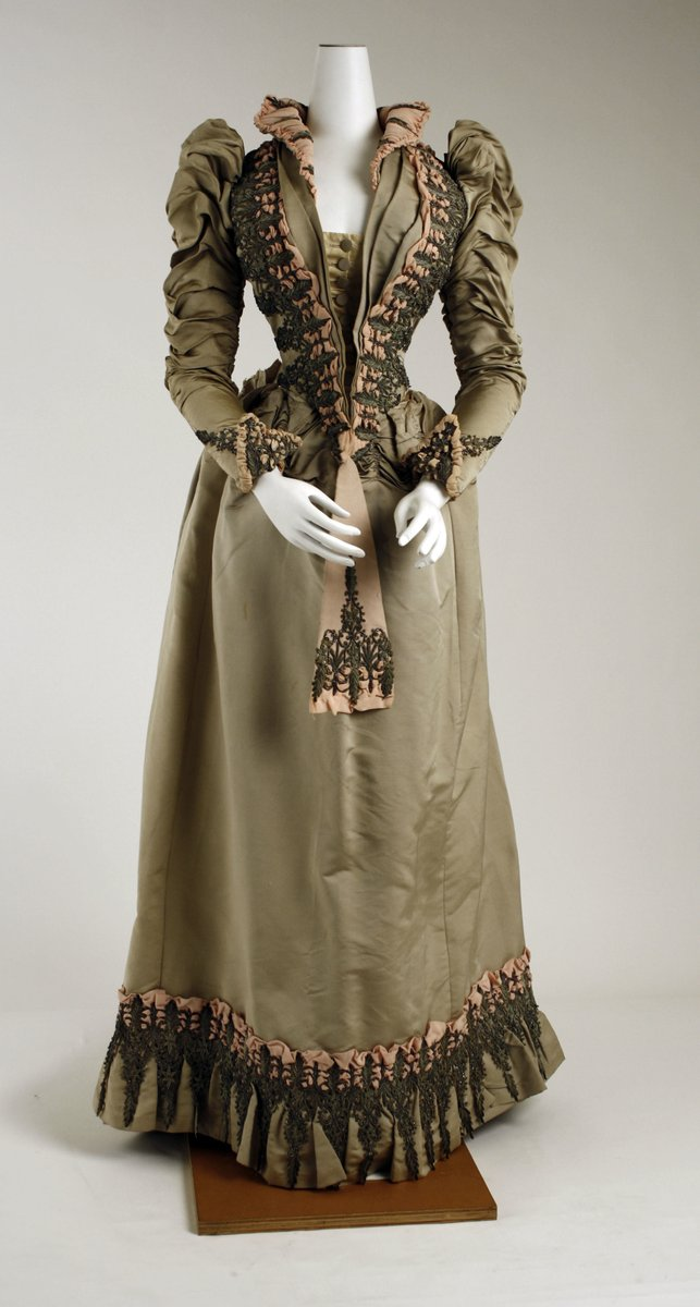 American ensemble. 1880s. Met Museum. Green and Peach narrow-waisted gown with black embroidery in beads and silk.