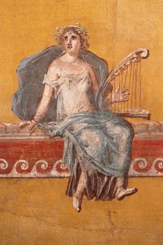 A Roman painting of a woman wearing a crown of laurels, playing a lyre on a red shelf; the background is orange ochre in color, very common around this period. via Wikimedia Commons - Public Domain