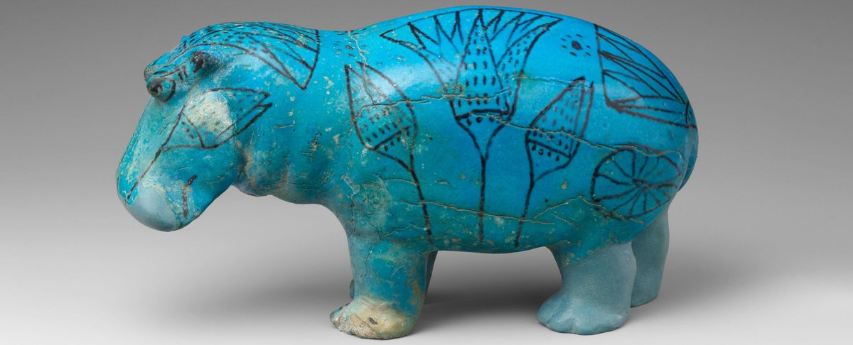 This is a hippo made of faience glass from Egypt. He is appropriates in Egyptian blue, and he has stylized flowers on him as well. He's lived at the Met Museum for the last 100 years.  From the Met Museum: Public Domain.