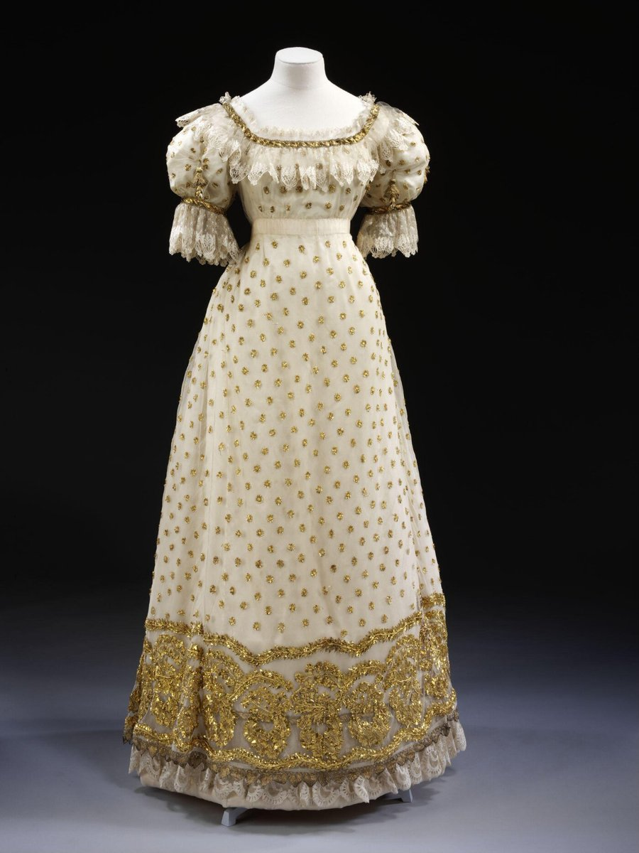 An empire waist gown  with gold embroidery.