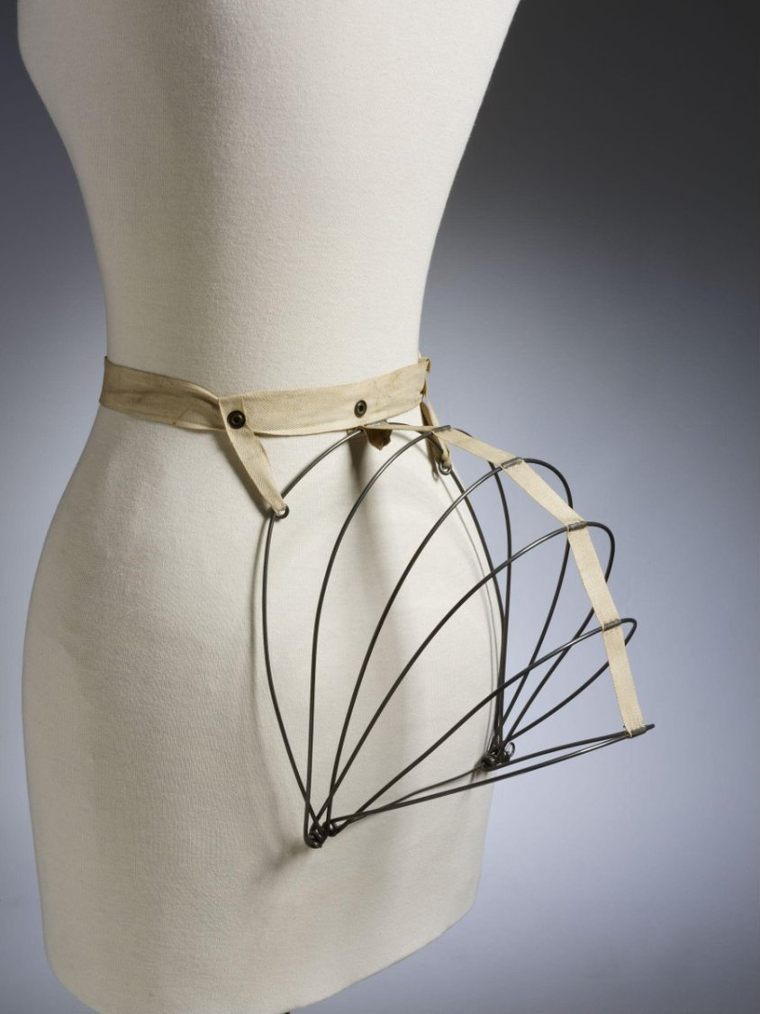 ©Victoria and Albert Museum, London - The bustle had first appeared in the late 1860s. It was then part of the 'crinolette', in which excess fabric left over from the once bell-shaped skirts was draped over the hips and bunched up behind. By the 1870s, the bustle had become a separate undergarment in its own right. The new form of bustle was known as a 'tournure' or 'dress-improver', as the word 'bustle' was considered vulgar by Victorian ladies.