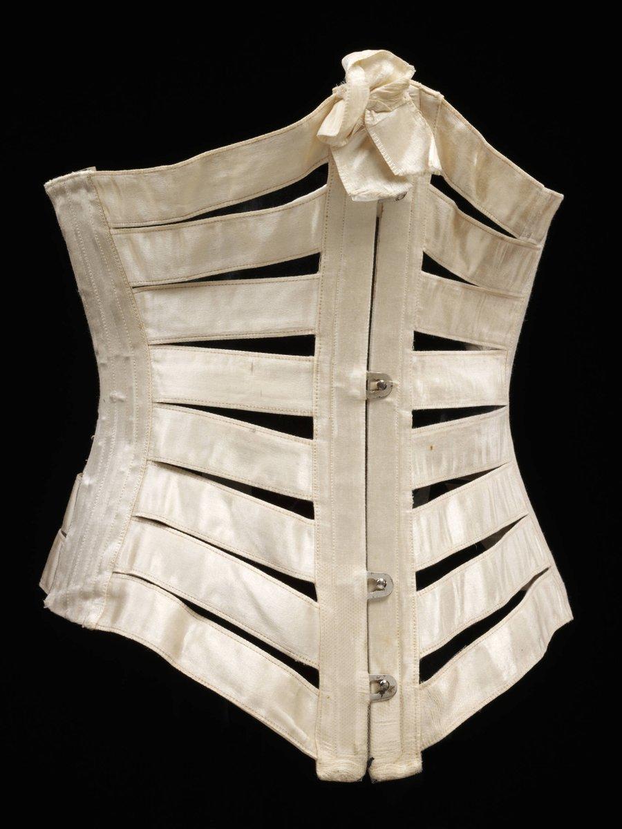 """Ribbon corset"" made from strips of cream silk satin ribbon connecting boning and lacings, metal fastenings. ©Victoria & Albert Museum, London"