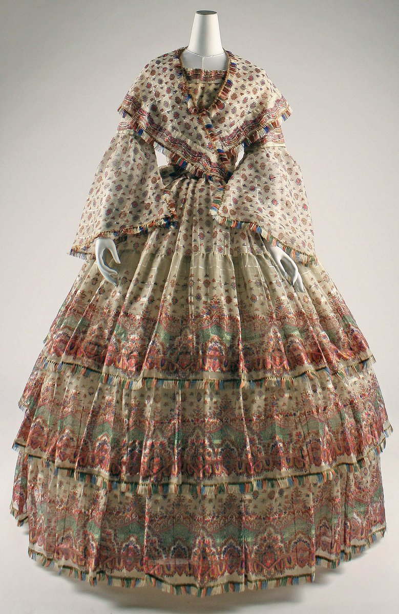 Nineteenth century gauze dresses incorporate the romance of the buta motif in fabrics that have no similarity to the original Kashmiri wools. The endemic and indivisible Paisley-wool ligature is dissociated in the West, chiefly because of its extrordinary popularity as it becomes a design motif for all seasons. By the twentieth century, paisley, in the West, came to be associated as much with silk and cotton - notably in home furnishings and men's neckties - as with wool. Met museum, public domain.