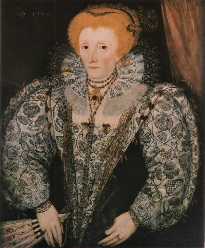 Elizabeth in a portrait with her red hair (a wig at this point) and large ruffs, her dress covered with blackwork embroidery. She is holding a fan and does not look particularly pleased.