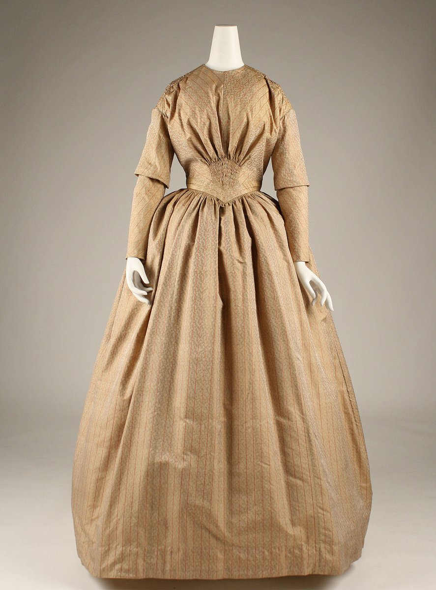 Caramel colored silk gown from 1846. Super snatched waist with tiny ruching, high waist, loose blouse, boxy shoulders and long sleeves. Long puffy skirt.
