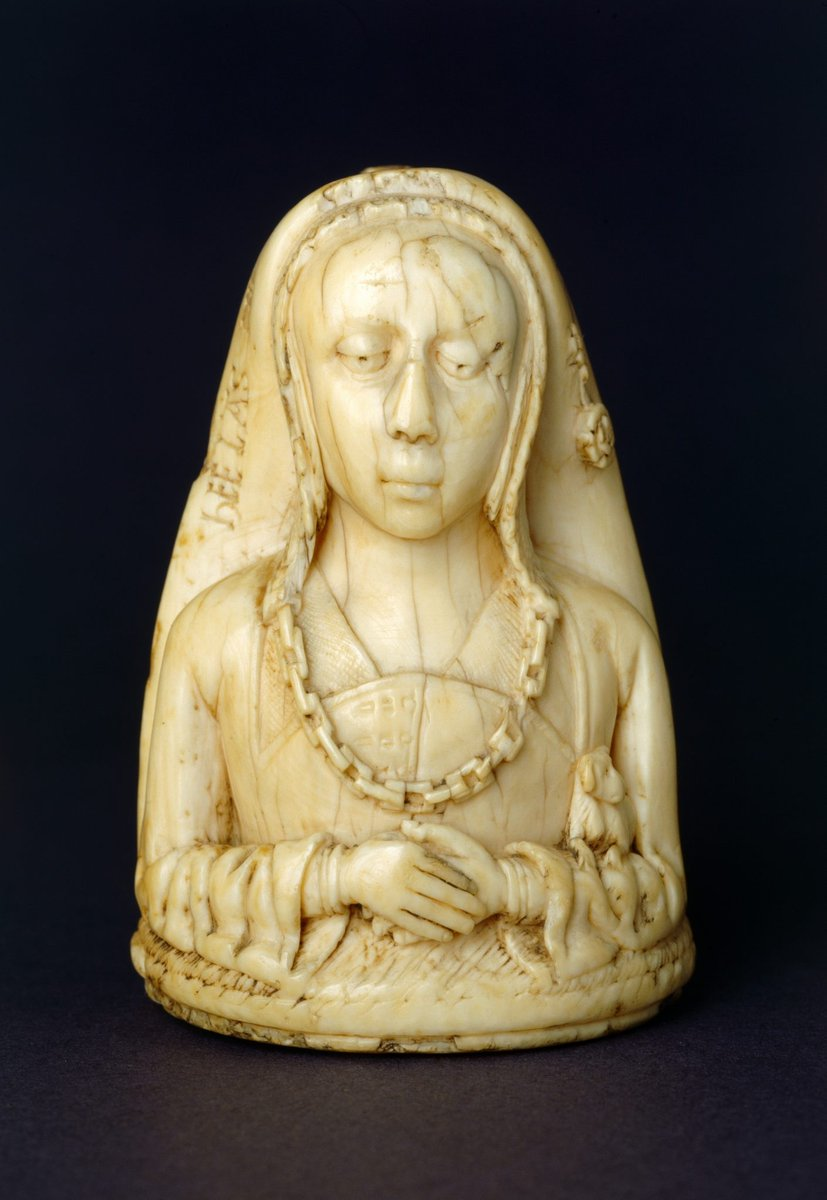 From English Heritage: The first is a small ivory pendant produced in the Netherlands in around 1500. Aesthetically, its two sides couldn't be more different. One side is carved with the bust of a rich lady in the prime of her life. She is clad in expensive clothes and carries a small lapdog. A heavy linked chain, doubtless of gold, hangs around her neck. It's the very image of wealth and worldly pride.