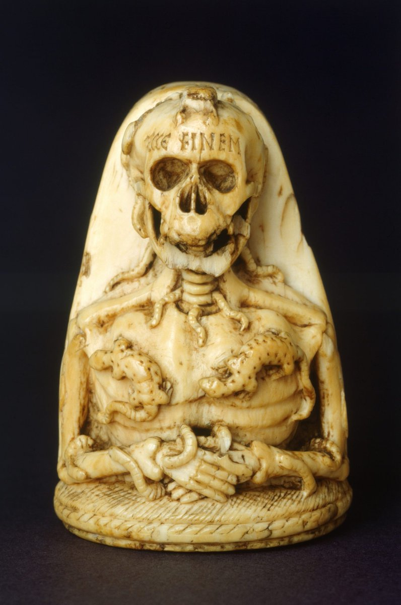 From English Heritage: But a Latin inscription around the veiled head strikes a different chord. 'Alas, I must die', it reads in translation.  This prepares the viewer for the horrific image adorning the opposing face. Here we are presented with the hideous reality of death — it shows a decomposing skeletal corpse being devoured by worms, frogs, slugs and salamanders. A Latin inscription on its forehead reads: 'This is the end'.