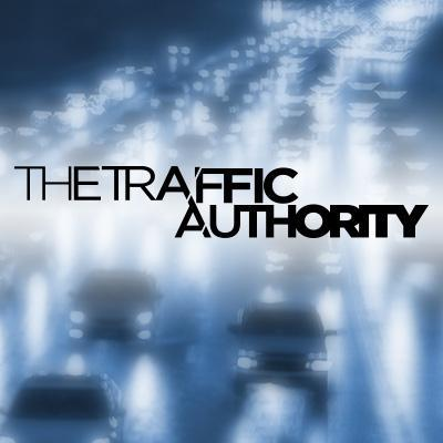 A hasy image of traffic with the inscription The Traffic Authority