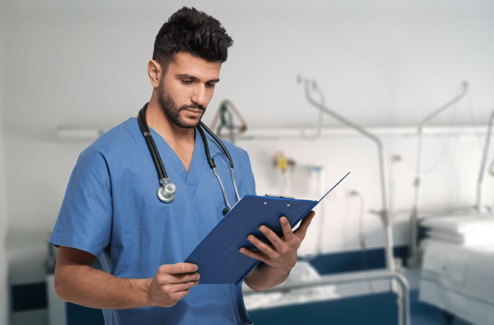 Doctor reviewing patient's chart cybersecurity