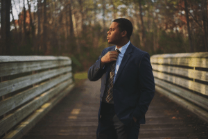 African American man in suit on a bridge