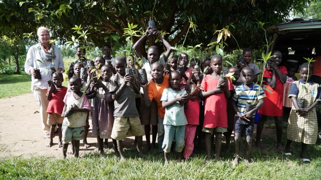 Barbara and the kids show off their mango seedlings