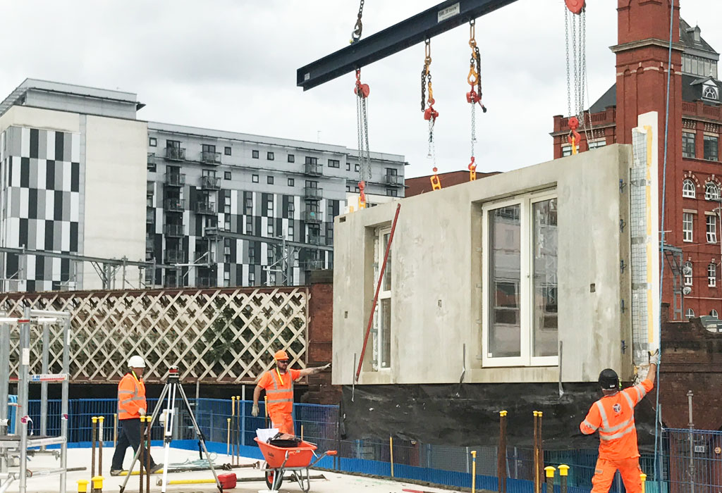 Precast concrete unit being lowered into position