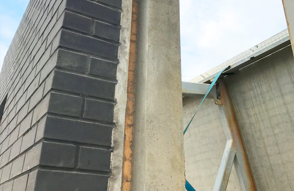 Architectural sandwich panels have windows fitted at the precast factory