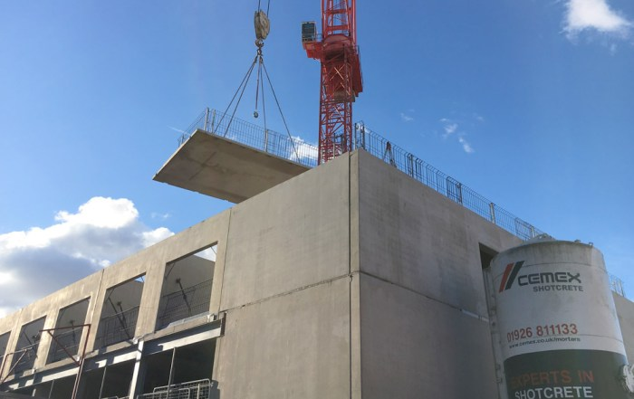 Offsite manufactured precast concrete unit being craned into place