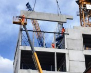 Precast unit quantities include 275 columns 318 beams 50 solid walls and 52 stair lift core boxes