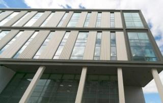 Two-storey factory pre-glazed cladding panels designed and installed by PCE