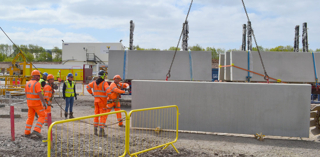 Offsite engineered precast concrete units arriving on site