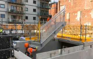 PCE installing stair flights with permanent handrail pre-fitted