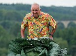 Ian Neale, 75, had the heaviest carrot (9lb 8oz), beetroot (3st) and cabbage (4st 10lb) at the Harrogate Autumn Flower Show in North Yorkshire yesterday
