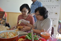 Volunteer Chun-Li Yang at Taiwanese table