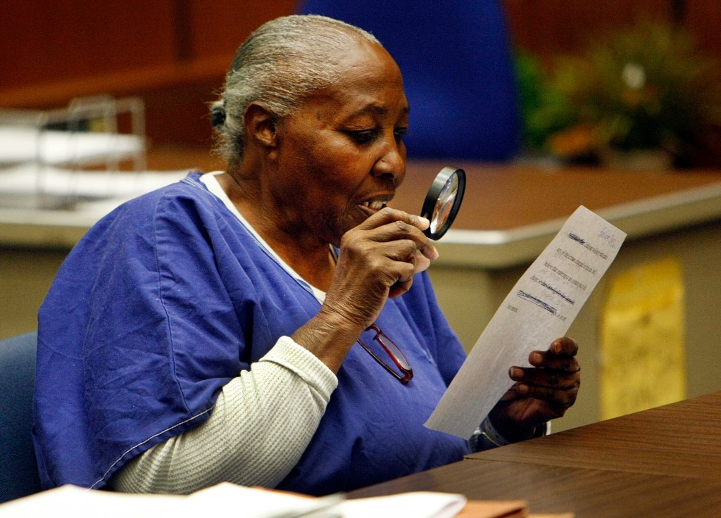 LOS ANGELES, CA - MARCH 24, 2014:   Mary Virginia Jones uses a magnifier to read her no contest plea to voluntary manslaughter in Los Angeles Superior Court  on March 24, 2014 as she is represented by law students at USC's Post- Conviction Justice Project. The 74-year-old woman is expected to be released from prison after serving 32 years for a murder allegedly committed by her abuser in 1981. The District Attorney's Office conducted an independent investigation and agreed to set aside her convictions in exchange for the no contest plea. (Al Seib / Los Angeles Times)