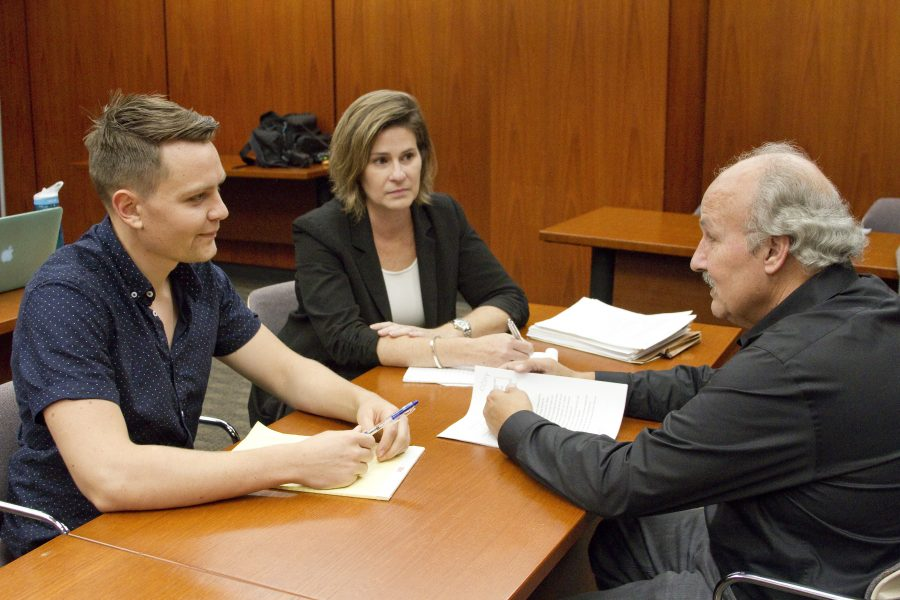 Heidi Rummel, co-director of the Post-Conviction Justice Project, in a meeting with then-student Alex Kirkpatrick (JD 2017) and client Marvin Mutch. With PCJP's representation, Mutch won parole after serving 40 years in prison for a crime he did not commit.