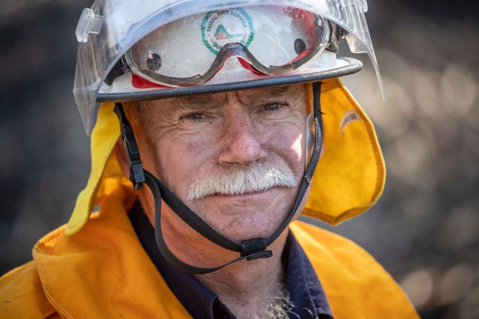 Photo: Firefighter Peter Orth helped put out spot fires at Binna Burra Road. (AAP: Glenn Hunt)