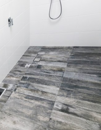 Laundry and bathroom renovation complete with modern grey wood-look tiles, Project Gallery