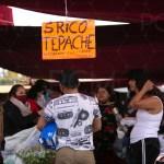 Mercado lleno de gente COVID-19