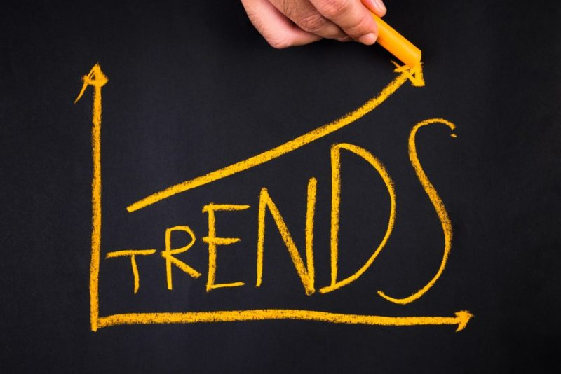 Hand writing Trends topic in growth graph on chalkboard