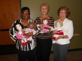 Judy, Georgia, and Jan, with dolls