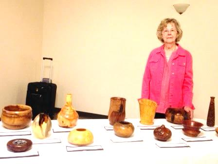 Judy Hendershot With Her Husband's Wood Carvings