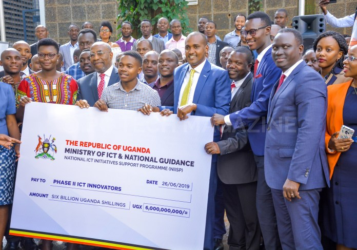 Rt. Hon. Ruhakana Rugunda and Hon. Frank Tumwebaze, on Wednesday officially handed over a shared UGX6 billion grant to the second cohort winners of the National ICT Initiatives Support Programme (NIISP). Photo by: OLUPOT NATHAN ERNEST/PC TECH MAGAZINE