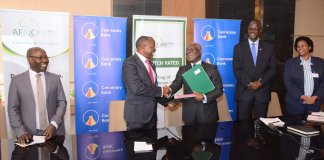 Fabian Kasi; MD & CEO of Centenary Bank (L), and Felix Bikpo; CEO of African Guarantee Fund Group shake hands after signing the AGF Loan Agreement. Photo by: Centenary Bank