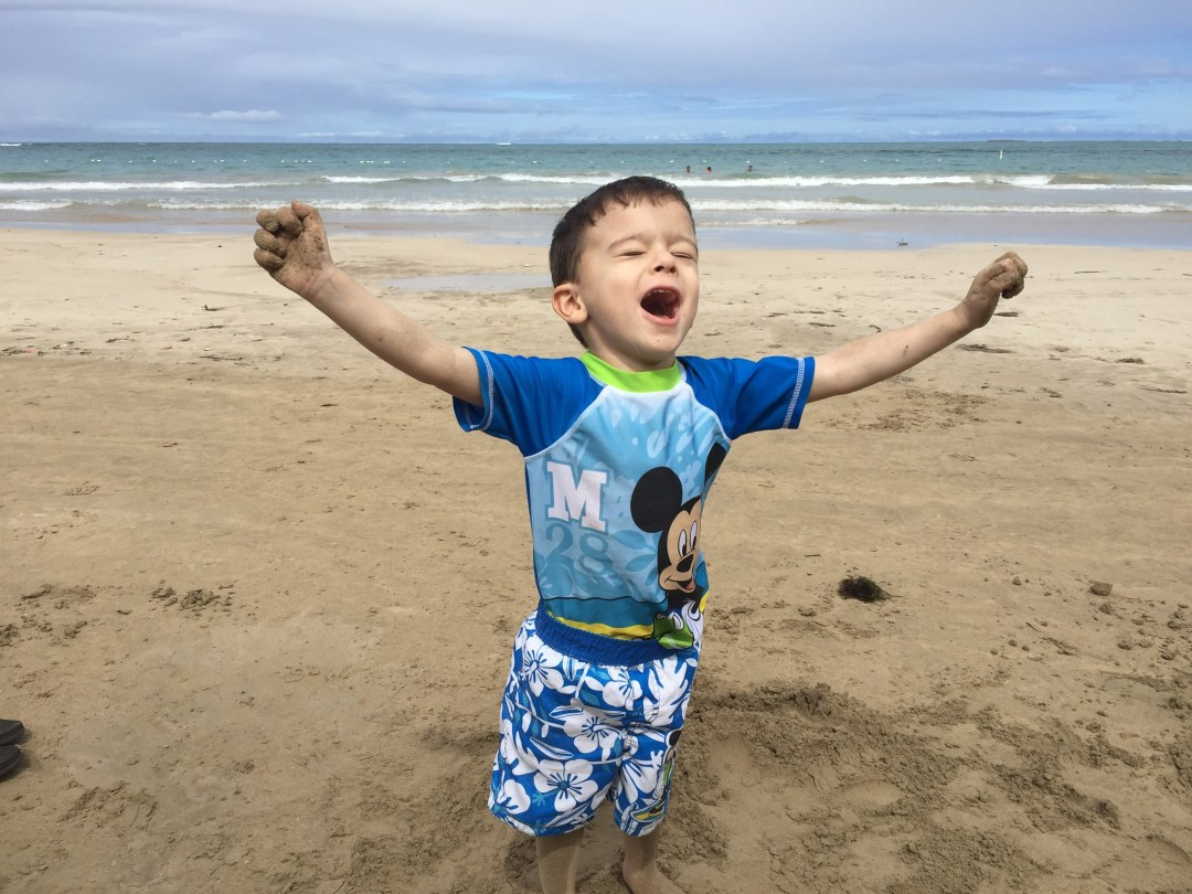Photo of a young boy happy on a beach