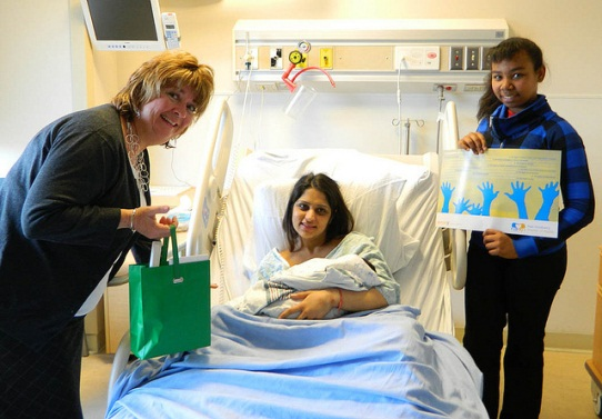 Naomi Ishmael (far right) making a presentation on children's rights in Peel to newborns and their parents at William Osler Hospital on National Child Day 2011.