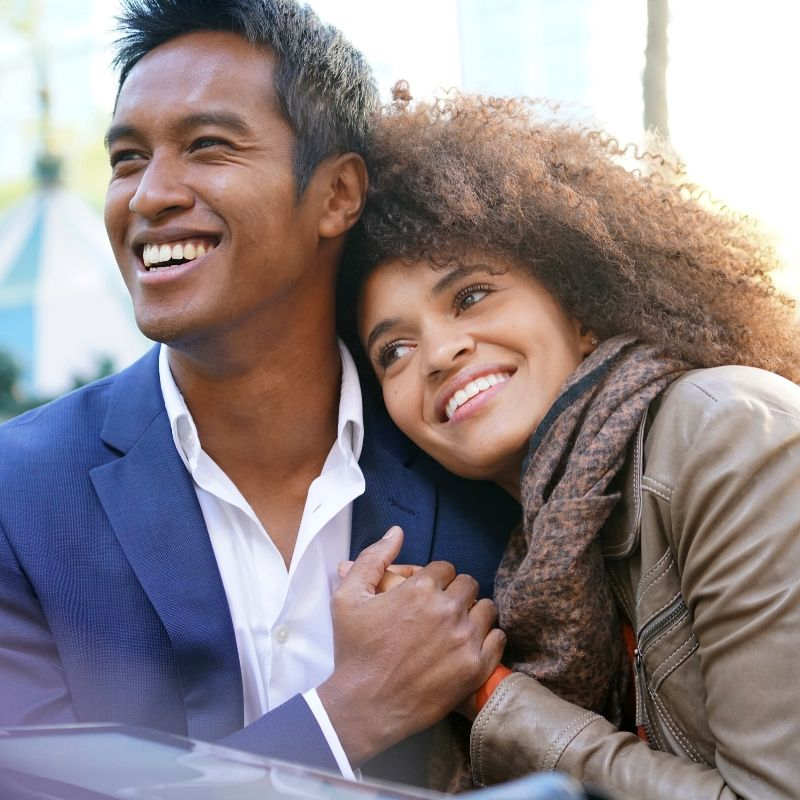 cute ethnic couple after professional Teeth Cleaning
