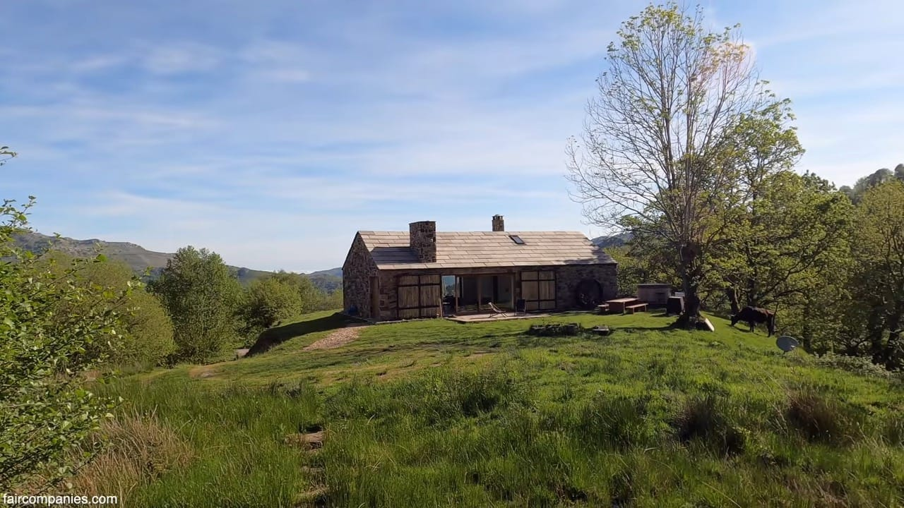 Ancient stone housebarn becomes couple's tranquil home-office