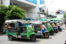 Tuk-tuks waiting for passenger at the exit of a Chao Praya pier in China town