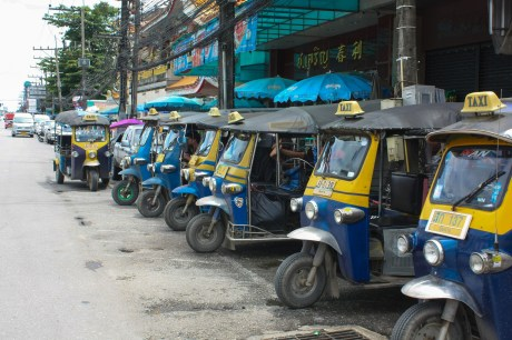 Tuk tuk row, all painted in blue and yellow