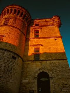 The towers of the castle in Gordes, illuminated by the falling sun