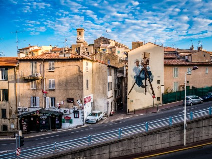 Cannes view near the old city. The film maker mural is characteristic of the town's major event, the film festival